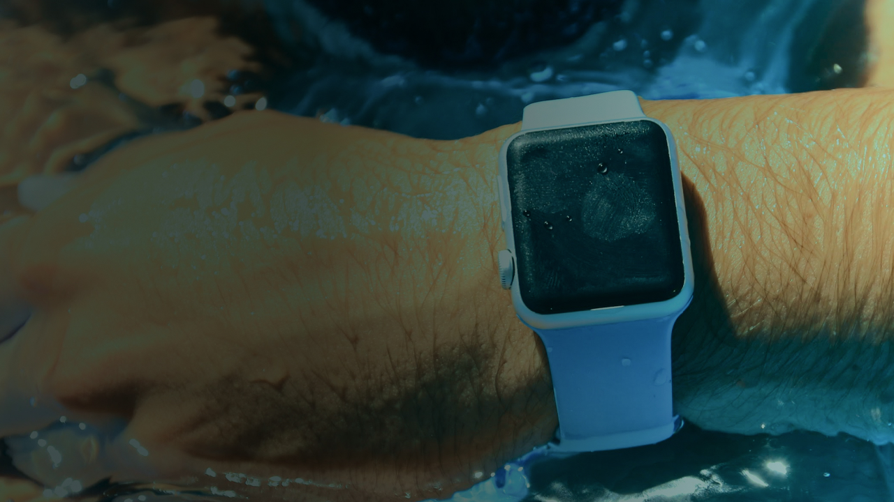 Smart watch submerged in water.