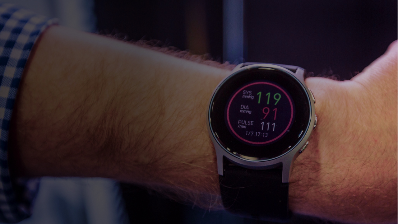 Smart watch displaying heart monitor app.